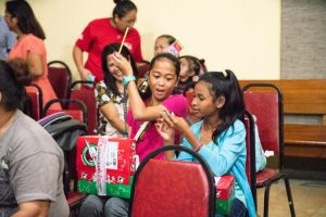 Eden, left, was excited to receive the gifts in her shoebox.