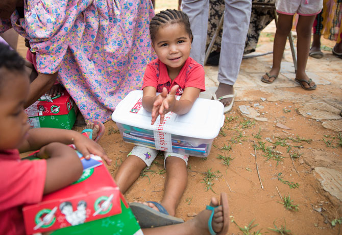 Little Girl holding shoebox gift
