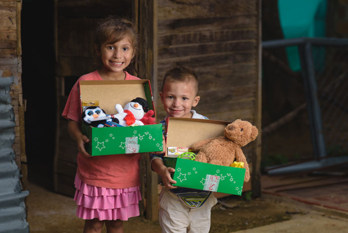 Siblings smile over shoebox gifts
