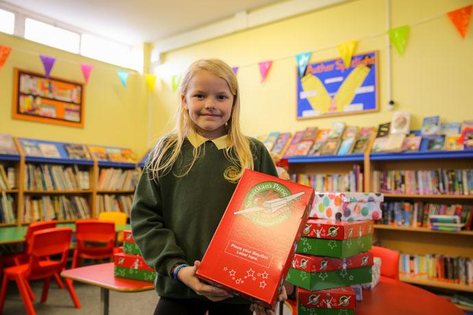 Cara holding a shoebox