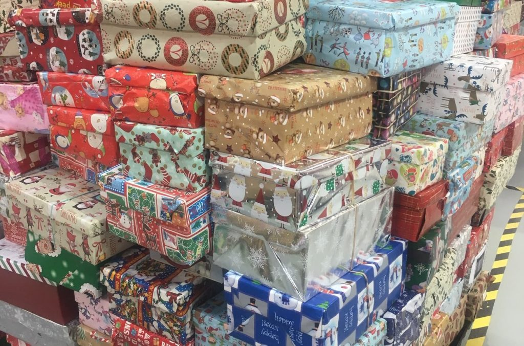 Pile of wrapped shoebox gifts